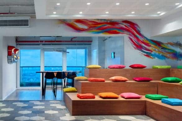 Tiered seating with multi coloured cushions