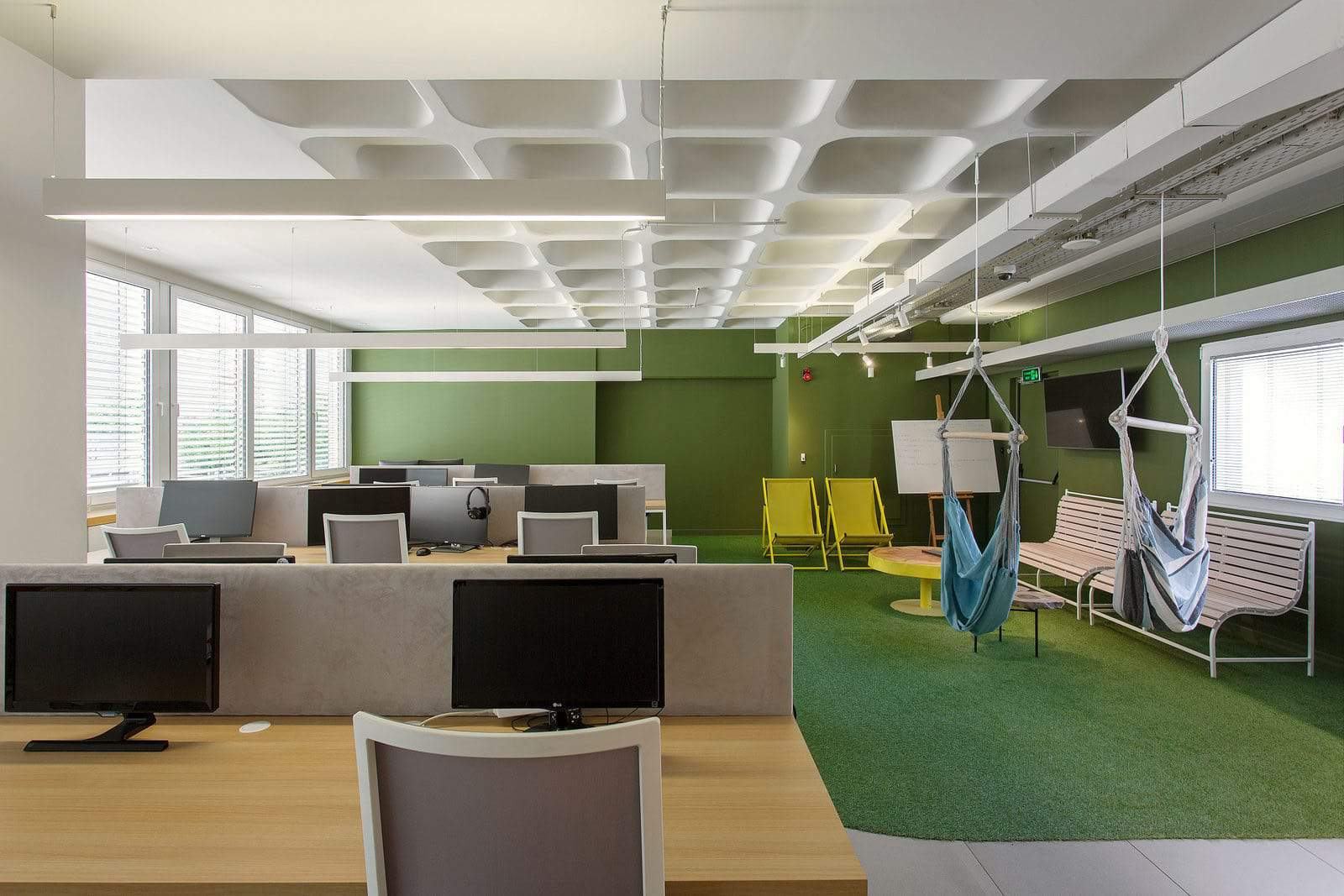 Ceiling suspended hammocks and artificial grass floor