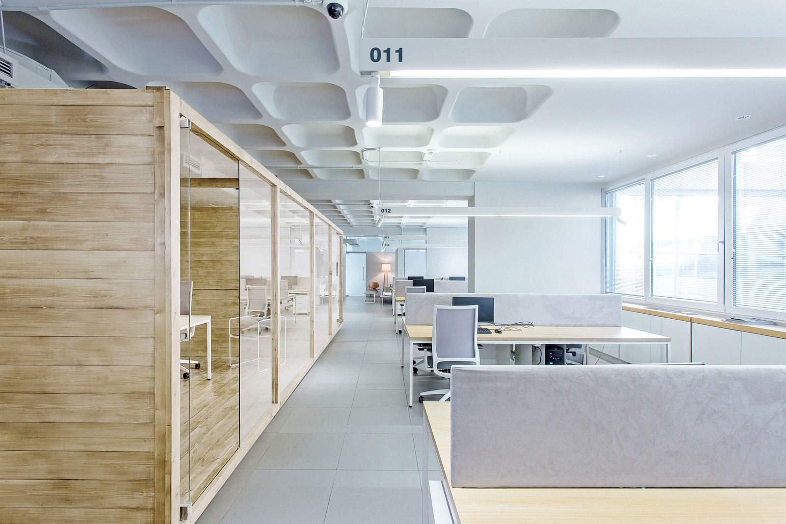 Viva Wallet open plan office space and office pods