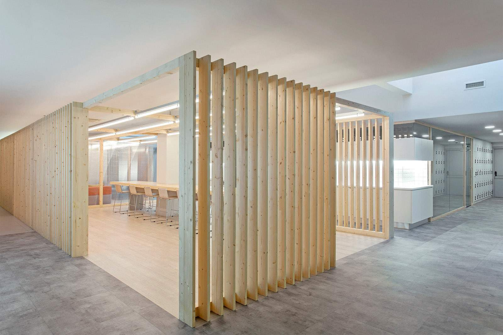 Meeting room with shutter style wood frame walls