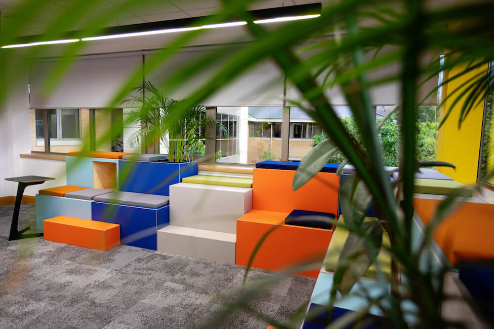 Vibrant Huddlebox shown in open plan office space